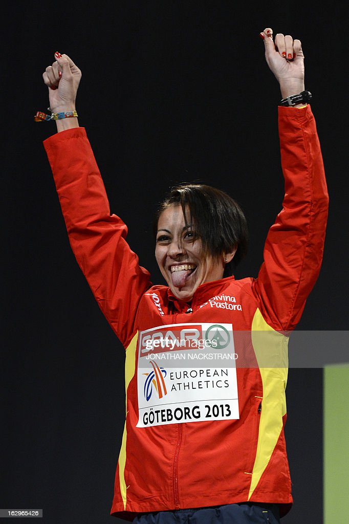 Second placed Spain's Isabel Macias celebrates on the podium after the women's 1500m final at the European Indoor athletics Championships in Gothenburg, Sweden, on March 2, 2013. AFP PHOTO / JONATHAN NACKSTRAND