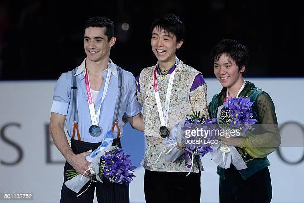 Second placed Spanish skater Javier Fernandez winner Japanese skater Yuzuru Hanyu and third placed Japanese skater Shoma Uno pose on the podium...