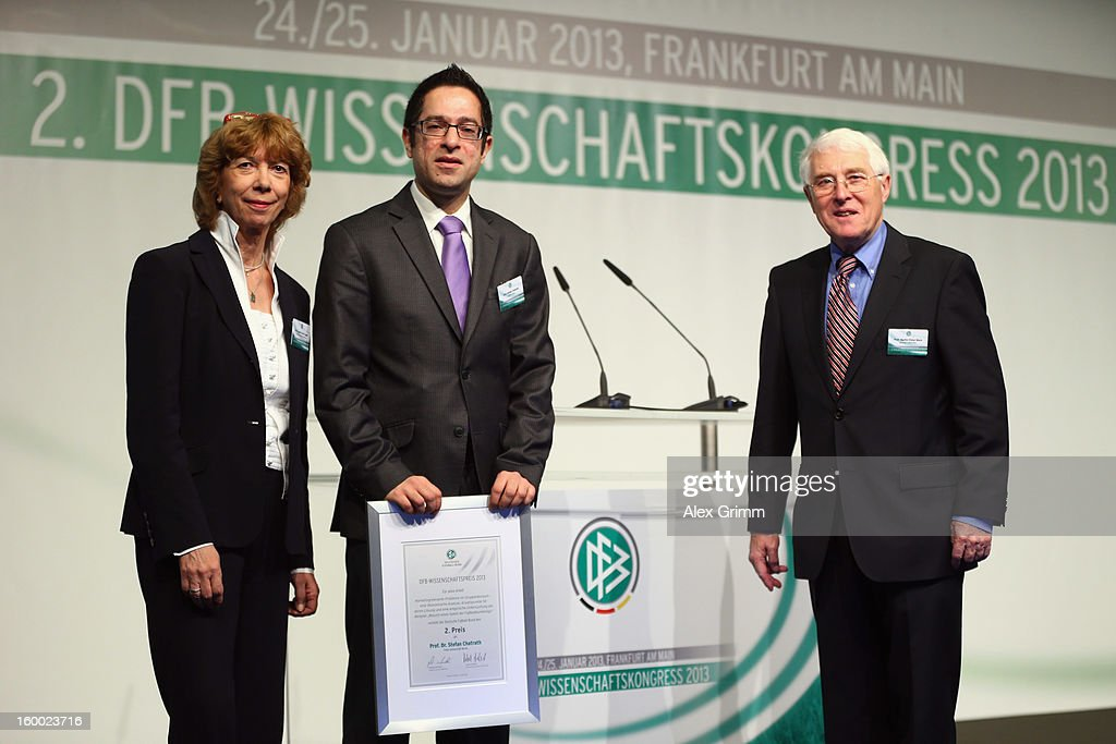 Second placed Stefan Chatrath poses with DOSB vice president Gudrun Doll-Tepper and Martin-Peter Buech, head of the DFB Science department, after the DFB Science Award during the DFB Science Congress 2013 at the Steigenberger Airport Hotel on January 25, 2013 in Frankfurt am Main, Germany.