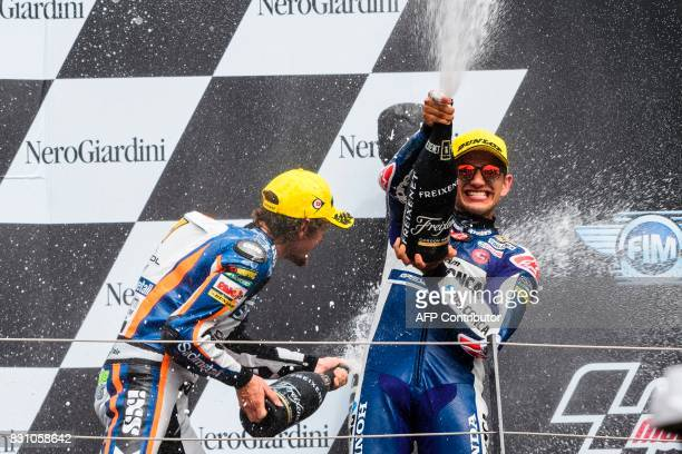 Second placed Sudmetall Schedl GP Racing's German rider Philipp Oettl and third placed Del Conca Gresini Moto3's Spanish rider Jorge Martin celebrate...