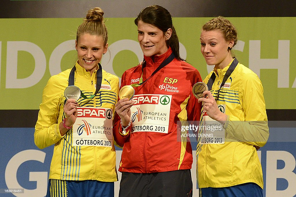 Second placed Sweden's Ebba Jungmark, winner Spain's Ruth Beitia and third placed Sweden's Emma Green Tregaro celebrate with their medals on the podium after the Women's High Jump final event at the European Indoor Athletics Championships in Gothenburg, Sweden, on March 3, 2013