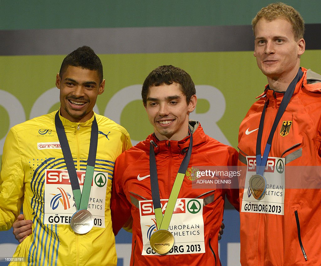 Second placed Sweden's Michel Torneus, winner Russia's Aleksandr Menkov and third placed Germany's Christian Reif stand with their medals on the podium after the Long Jump Men's Final at the European Indoor Athletics Championships in Gothenburg, Sweden, on March 3, 2013