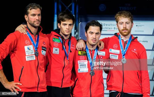 Second placed Swiss Benjamin Steffen Michele Niggeler Max Heinzer and Georg Kuhn stand on the podium after the team men's epee final between...