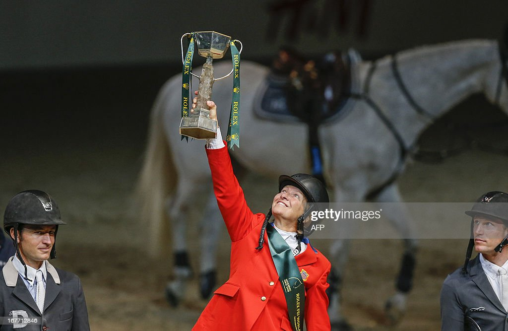 Second placed Switzerland's Steve Guerdat, first placed US Beezie Madden and third placed France's Kevin Staut hold their trophies during the awarding ceremony at the Rolex FEI World Cup jumping at the Gothenburg Horse Show, in Goteborg, Sweden on April 28, 2013.