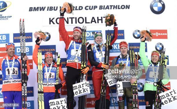 Second placed team USA Lowell Bailey and Susan Dunklee winner team Austria Simon Eder and Lisa Hauser and third placed team Germany Roman Rees and...