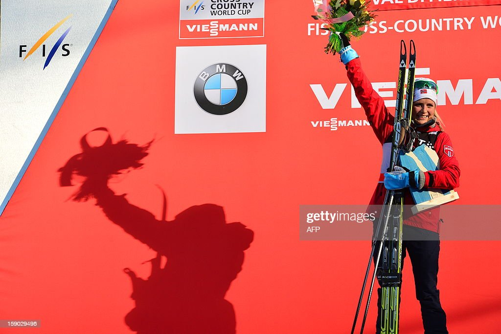Second placed Therese Johaug of Norway celebrates on the podium of the women's 9km free final climb pursuit of the Tour de Ski in Val di Fiemme on January 6, 2013. Justyna Kowalczyk of Poland won the race ahead Therese Johaug of Norway and Kristin Stoermer Steira of Norway.