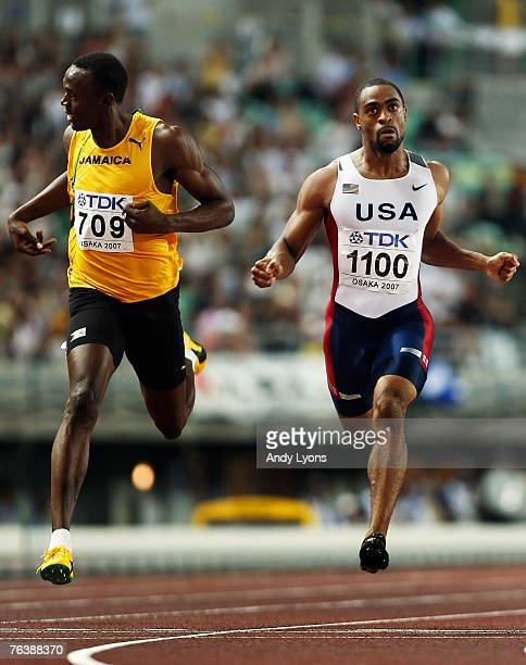 Second placed Usain Bolt of Jamaica and race winner Tyson Gay of the United States of America cross the finish line during the Men's 200m Final on...
