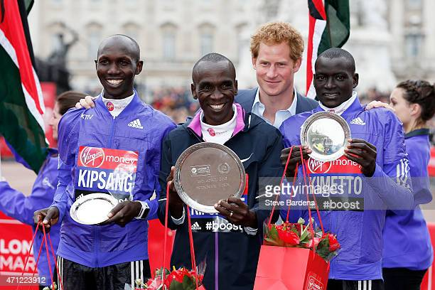 Second placed Wilson Kipsang of Kenya first placed Eliud Kipchoge of Kenya Prince Harry and third placed Dennis Kimetto of Kenya pose for the cameras...