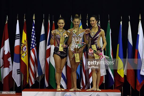 Second placed Yeon Jae Son of Korea Winner Aleksandra Soldatova of Russia and Third placed Neta Rivkin ofIsrael in the podium after the ball final of...