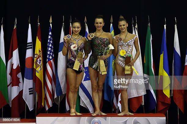Second placed Yeon Jae Son of Korea Winner Ganna Rizatdinova of Ukraine and Third placed Aleksandra Soldatova of Russia in the podium after the ball...