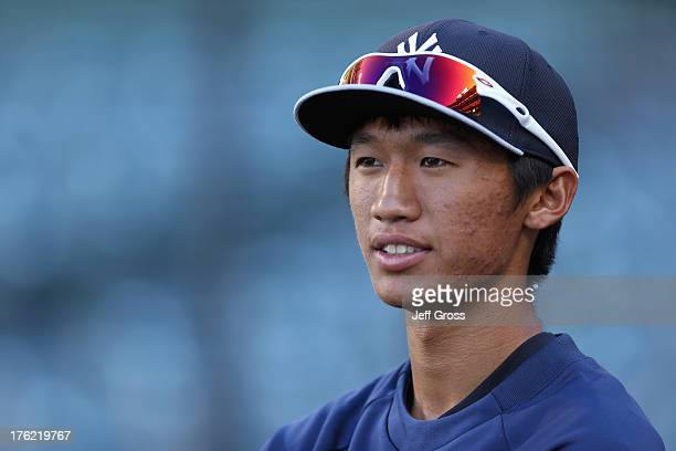 2013 second round draft pick for the New York Yankees Gosuke Katoh looks on before taking batting practice prior to the start of the game against the...