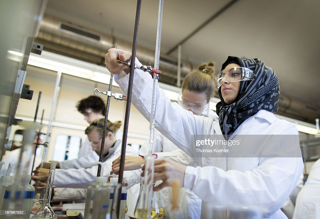 Second semester students in the nutrition technology department seen here working on acid base volumetric analysis at the Beuth technical college on October 31, 2013 in Berlin, Germany.