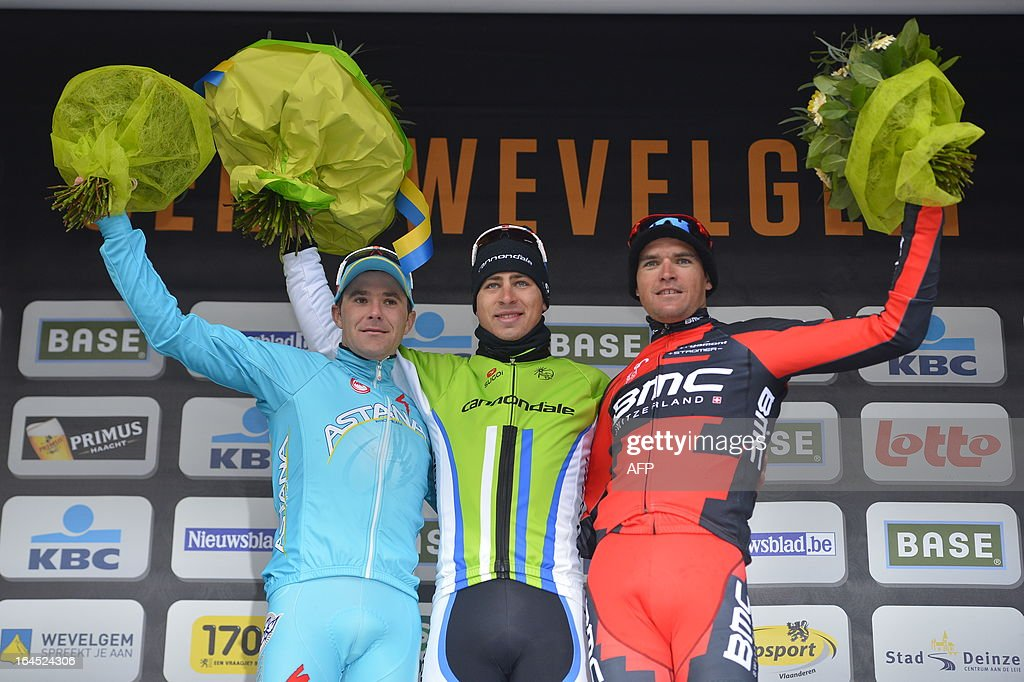 Second Slovenian Borut Bozic of Pro Team Astana, winner Slovakian Peter Sagan of Liquigas-Cannondale and third placed Belgian Greg Van Avermaet of BMC Racing Team celebrate on the podium after the 75th edition of the Gent-Wevelgem one day cycling race, 190km from Gistel to Wevelgem on March 24, 2013. The organisation decided yesterday to shorten the race with 47,5km because of the bad weather conditions. AFP PHOTO / BELGA / ERIC LALMAND