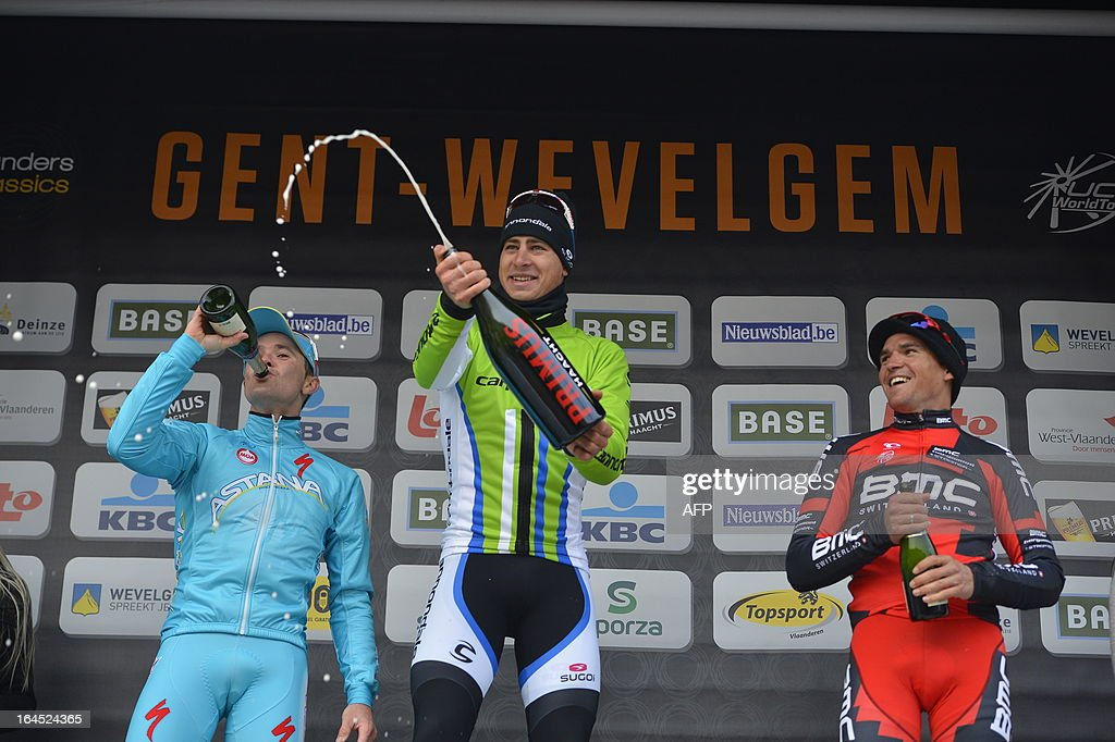 Second Slovenian Borut Bozic of Pro Team Astana, winner Slovakian Peter Sagan of Liquigas-Cannondale and third placed Belgian Greg Van Avermaet of BMC Racing Team celebrate with champagne on the podium after the 75th edition of the Gent-Wevelgem one day cycling race, 190km from Gistel to Wevelgem on March 24, 2013. The organisation decided yesterday to shorten the race with 47,5km because of the bad weather conditions.