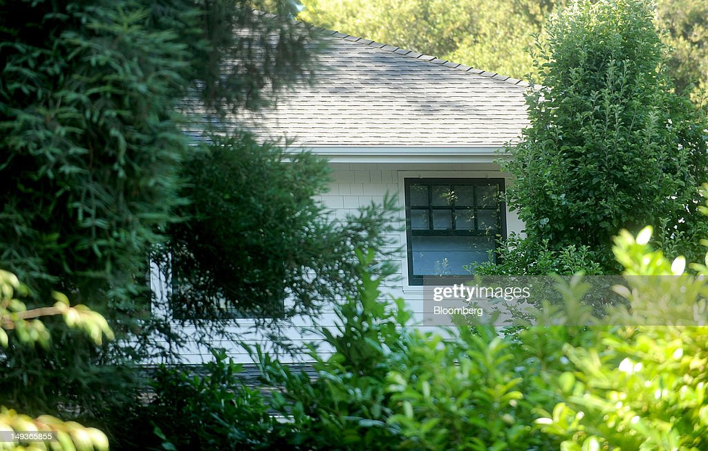 A second story window is seen from behind trees at Facebook Inc's founder Mark Zuckerberg's house in Palo Alto California US on Saturday July 14 2012...