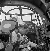 Second test pilot Sydney Albert 'Bill' Thorn in the cockpit of an Avro Lancaster heavy bomber at an Avro factory in Greater Manchester 16th March...