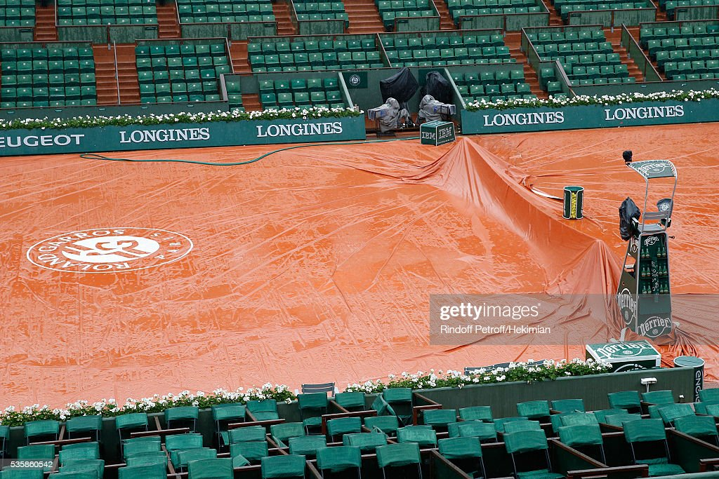Second time in Roland Garros Tournament history that a full day is canceled - Illustartion view of the Central Court under the rain during Day Nine of the 2016 French Tennis Open at Roland Garros on May 30, 2016 in Paris, France.