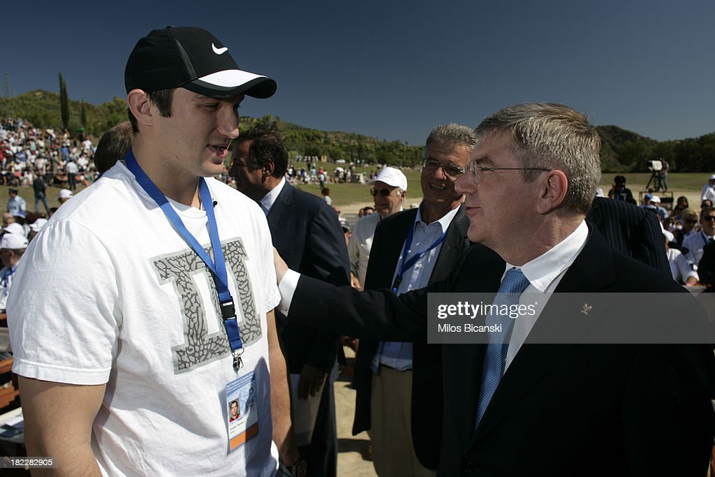 Second torchbearer Alexander Ovechkin of Russia, left, professional ice hockey winger and captain of the Washington Capitals with IOC President Thomas Bachl at Ancient Olympia during the lighting ceremony of the Olympic Flame for the Sochi 2014 Winter Olympic Games at Ancient Olympia on September 29, 2013 in Olympia, Greece.