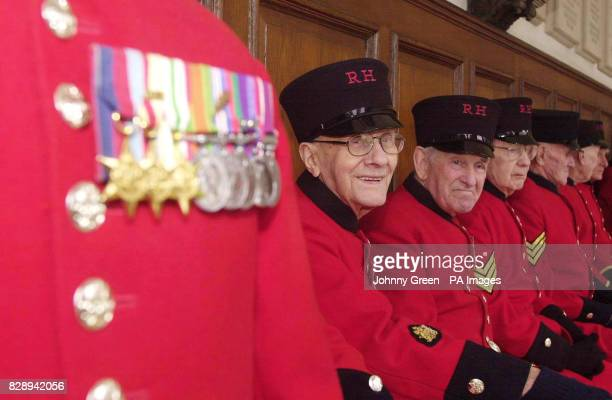 Second World War veterans Gordon White from Greenwich in southeast London and Tony Tremarco from Liverpool join fellow veterans at Royal Chelsea...