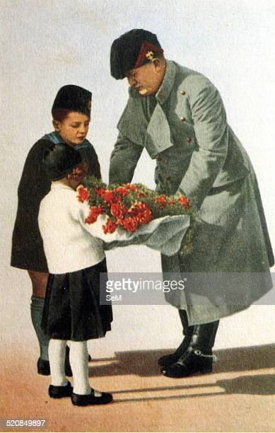 Second World WarWar in ItalyFascism The Duce Benito Mussolini and children in a fascist propaganda poster