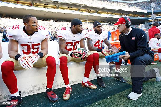 Secondary Coach Ed Donatell of the San Francisco 49ers talks with Eric Reid Perrish Cox and Antoine Bethea during the game against the Seattle...