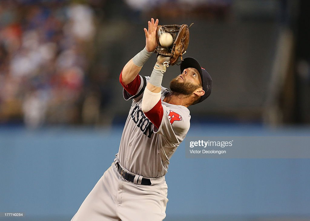Secondbaseman <a gi-track='captionPersonalityLinkClicked' href=/galleries/search?phrase=Dustin+Pedroia&family=editorial&specificpeople=836339 ng-click='$event.stopPropagation()'>Dustin Pedroia</a> #15 of the Boston Red Sox gets under a fly ball for the third out in the seventh inning during the MLB game against the Los Angeles Dodgers at Dodger Stadium on August 25, 2013 in Los Angeles, California. The Red Sox defeated the Dodgers 8-1.