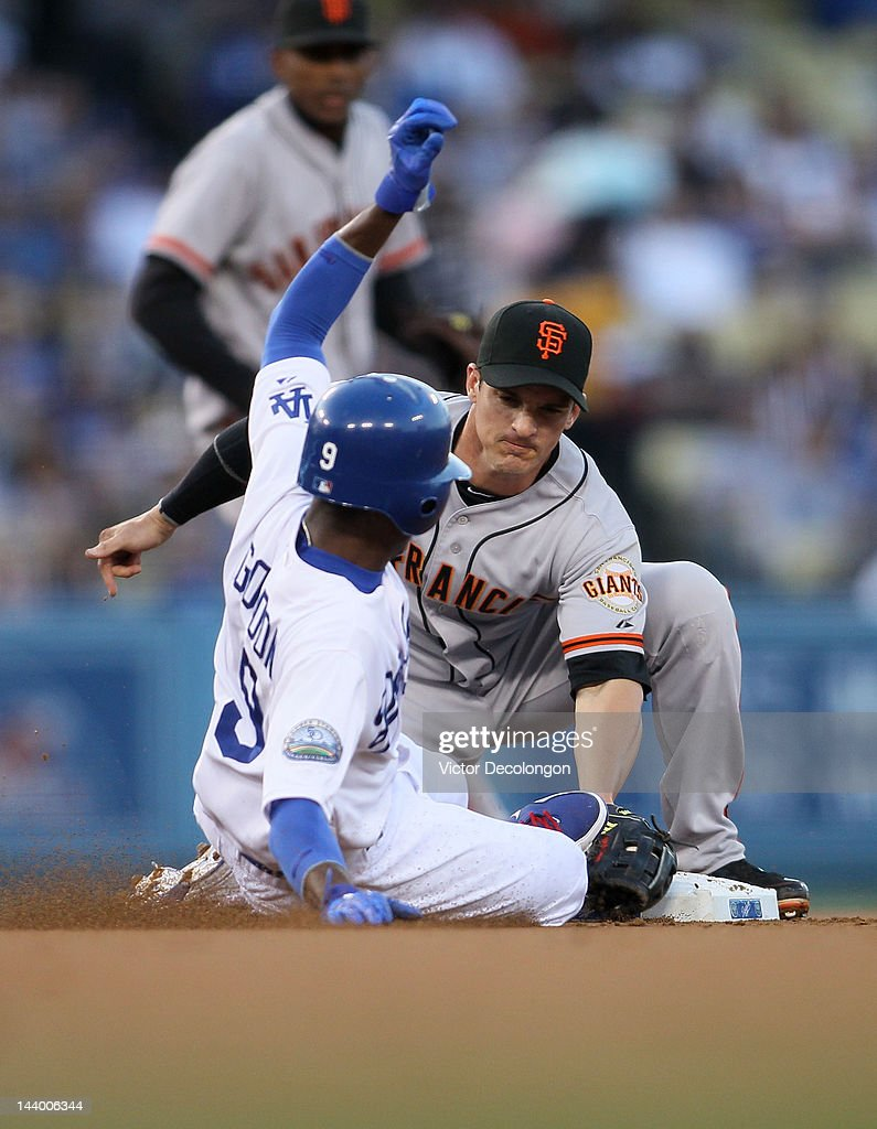 Secondbaseman Ryan Theriot #5 of the San Francisco Giants tags Dee Gordon #9 of the Los Angeles Dodgers at second base for an out in the first inning during the MLB game at Dodger Stadium on May 7, 2012 in Los Angeles, California. Gordon was tagged out trying to steal second.