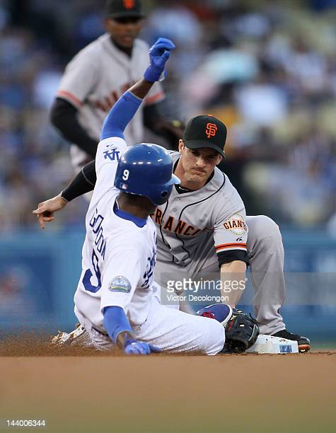 Secondbaseman Ryan Theriot of the San Francisco Giants tags Dee Gordon of the Los Angeles Dodgers at second base for an out in the first inning...