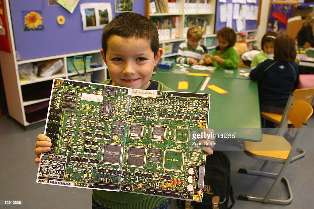 A second-grade a child shows holds a photograph of a circuit board in a book about robots in the elementary school at the John F. Kennedy Schule dual-language public school on September 18, 2008 in Berlin, Germany. The German government will host a summit on education in Germany scheduled for mid-October in Dresden. Germany has consistantly fallen behind in recent years in comparison to other European countries in the Pisa education surveys, and Education Minister Annette Schavan is pushing for an 8 percent increase in the national educaiton budget for 2009.