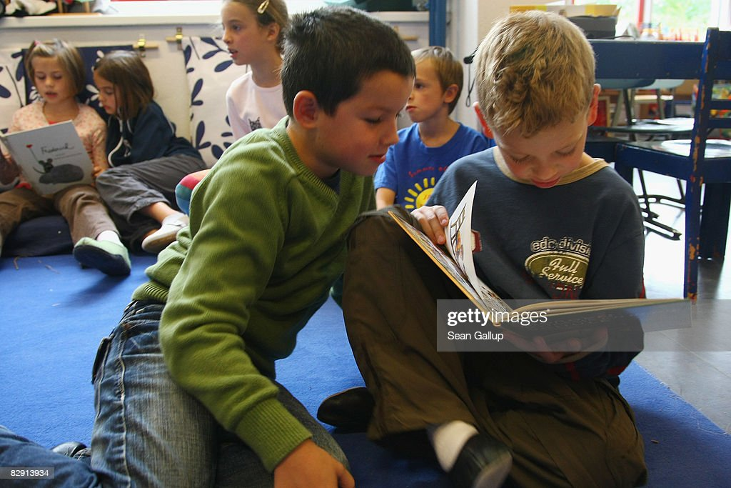 Second-grade children read books in the elementary school at the John F. Kennedy Schule dual-language public school on September 18, 2008 in Berlin, Germany. The German government will host a summit on education in Germany scheduled for mid-October in Dresden. Germany has consistantly fallen behind in recent years in comparison to other European countries in the Pisa education surveys, and Education Minister Annette Schavan is pushing for an 8 percent increase in the national educaiton budget for 2009.