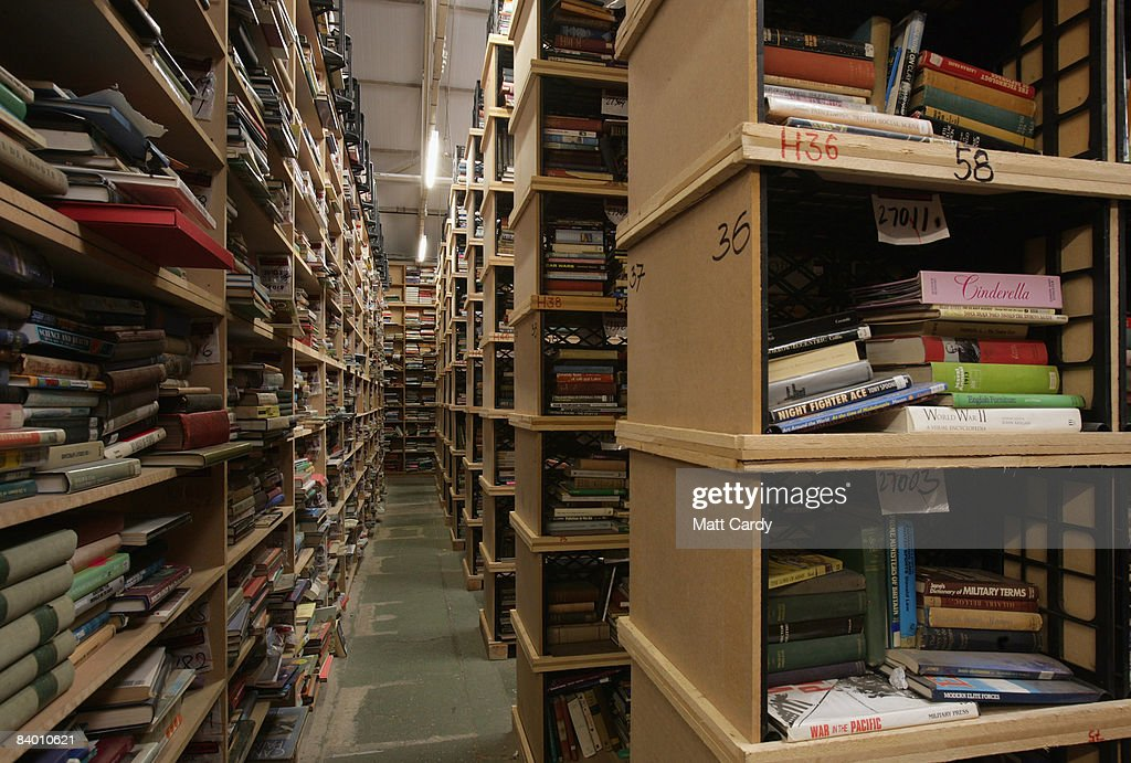 Secondhand books are stacked on shelves at the Bookbarn International in one of their warehouses on December 12, 2008 near Hallatrow in Somerset, England. Currently selling up to several thousand books a day and mostly online via Web sites such as Amazon.com, Bookbarn International is the UK's largest second hand book warehouse with over 5 million titles stored in two giant barns in a field in Somerset. Helped in part by the credit crunch, sales of second hand books have risen sharply recently with the weak British pound only helping the Bookbarn to sell more books internationally. (Photo by Matt Cardy/Getty Images).