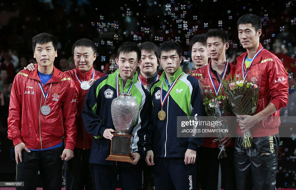 Second-placed China's Hao Shuai (L) and Ma Lin (2nd L), winners Taiwan's Chen Chien-An (3rd L) and Chuang Chih-Yuan (4th R), and tied for third place Japan's Jun Mizutani (4th L) and Matsudarai Kenta (3rd R) and China's Zhou Yu (2nd R) and Wang Liqin (R) pose on the podium of the Men's Doubles of the World Table Tennis Championships on May 19, 2013 in Paris.