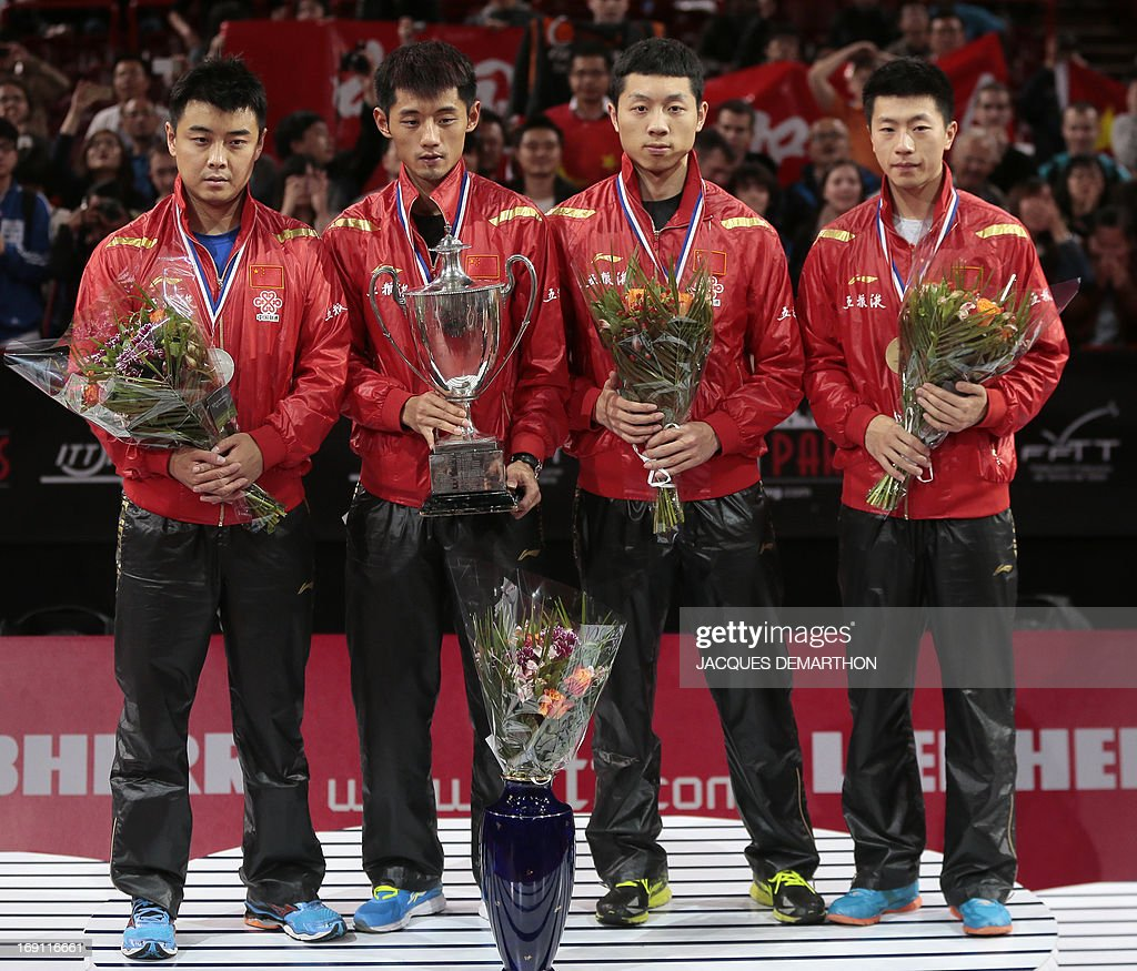 Second-placed China's Wang Hao winner Zhang Jike, tied for third Xu Xin and Ma Long stand on the podium on May 20, 2013 in Paris, during the Men's Singles final ceremony of the World Table Tennis Championships.