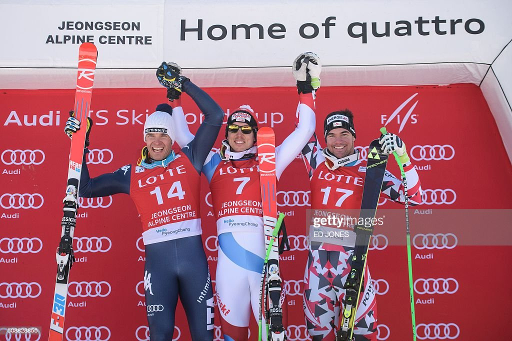 Second-placed Christof Innerhofer of Italy, first-placed Carlo Janka of Switzerland and third-placed Vincent Kriechmayr of Austria pose on the podium after the 8th men's super-G event at the FIS Alpine Ski World Cup in Jeongseon county, some 150 kms east of Seoul on February 7, 2016. The FIS Ski Men's World Cup runs from February 6 to 7 and is the first official test event for the Pyeongchang 2018 Winter Olympics. AFP PHOTO / Ed Jones / AFP / ED JONES