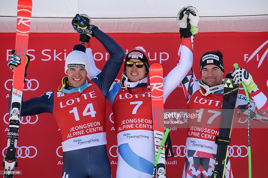 )L to R) Second-placed Christof Innerhofer of Italy, first-placed Carlo Janka of Switzerland and third-placed Vincent Kriechmayr of Austria pose on the podium for the 8th men's super-G event at the FIS Alpine Ski World Cup in Jeongseon county, some 150 kms east of Seoul on February 7, 2016. The FIS Ski Men's World Cup runs from February 6 to 7 and is the first official test event for the Pyeongchang 2018 Winter Olympics. AFP PHOTO / Ed Jones / AFP / ED JONES