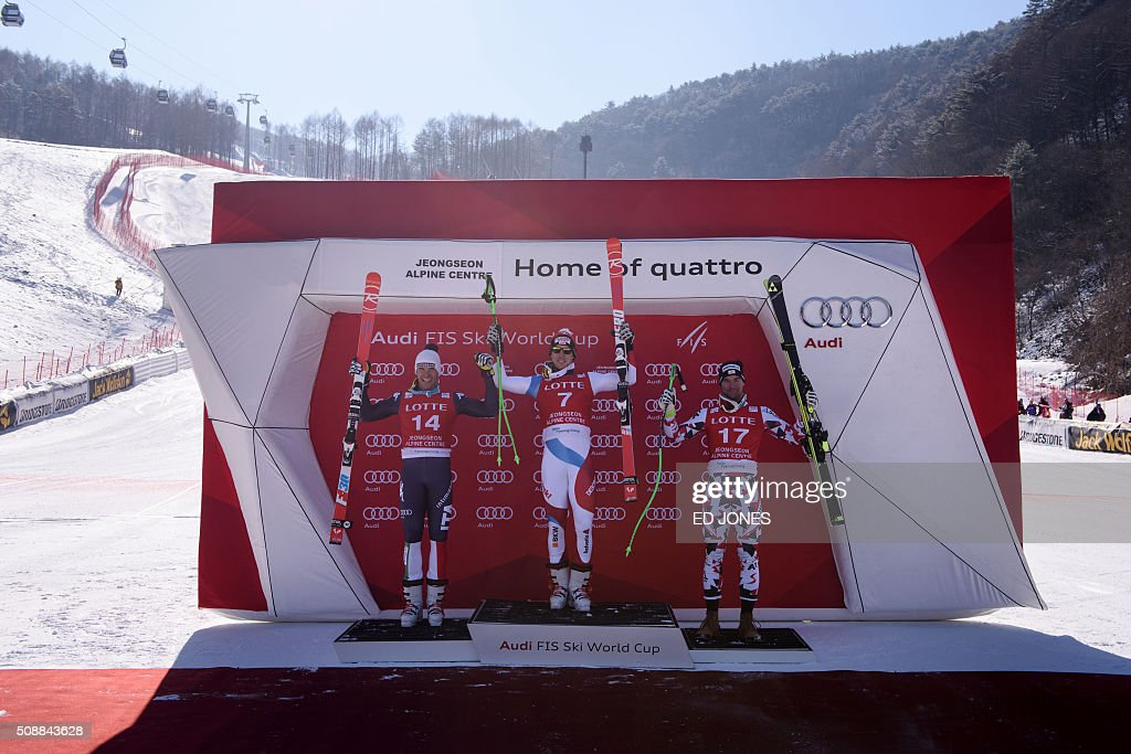 Second-placed Christof Innerhofer of Italy, first-placed Carlo Janka of Switzerland and third-placed Vincent Kriechmayr of Austria pose on the podium for the 8th men's super-G event at the FIS Alpine Ski World Cup in Jeongseon county, some 150 kms east of Seoul on February 7, 2016. The FIS Ski Men's World Cup runs from February 6 to 7 and is the first official test event for the Pyeongchang 2018 Winter Olympics. AFP PHOTO / Ed Jones / AFP / ED JONES