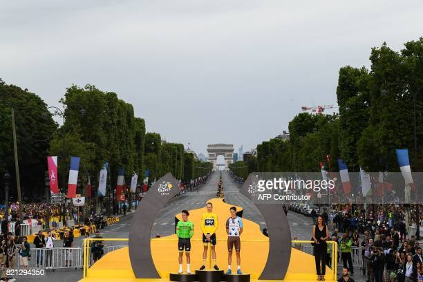 Secondplaced Colombia's Rigoberto Uran Tour de France 2017's winner Great Britain's Christopher Froome wearing the overall leader's yellow jersey and...