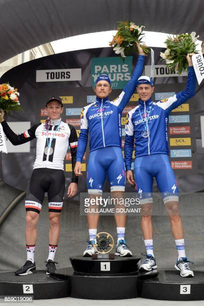 Secondplaced Danish Soren Kragh Andersen of team Sunweb firstplaced Italian cyclist Matteo Trentin of team Quick Step Floors and thirdplaced Dutch...