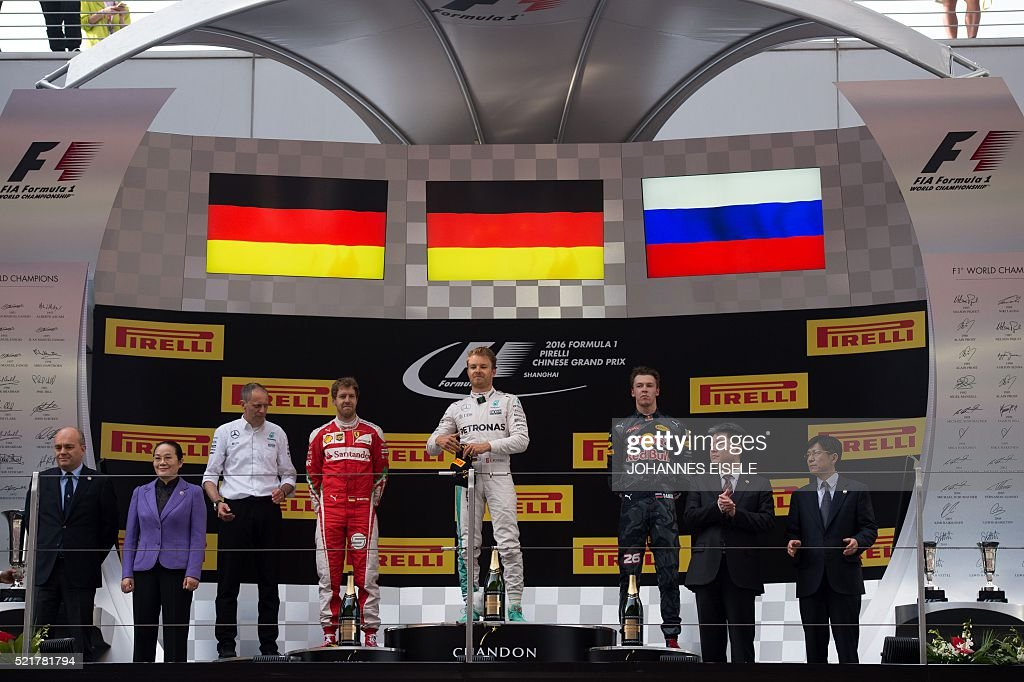 Secondplaced Ferrari's German driver Sebastian Vettel winner Mercedes AMG Petronas F1 Team's German driver Nico Rosberg and thirdplaced Red Bull...