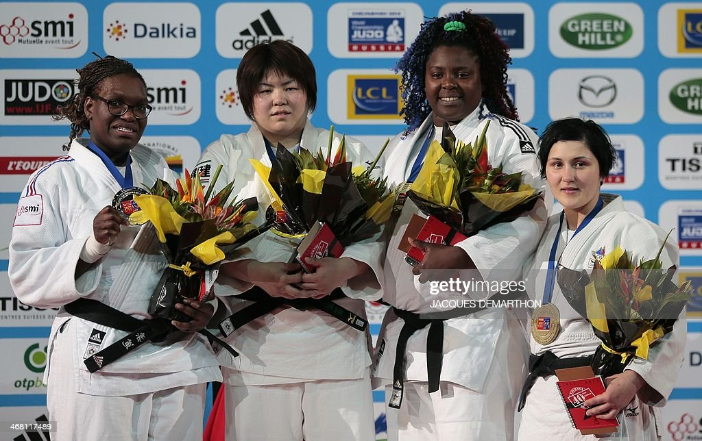 Secondplaced France's Emilie Andeol winner Japan's Yamabe Kanae equally thirdplaced Cuba's Idalys Ortiz and Slovenia's Lucija pose during the podium...