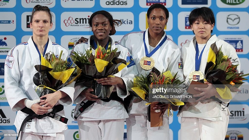 Secondplaced French AnneLaure Bellard firstplaced French Clarisse Agbegnenou thirdplaced Dutch Anicka van Emden and Japanese Tashiro Miku pose while...