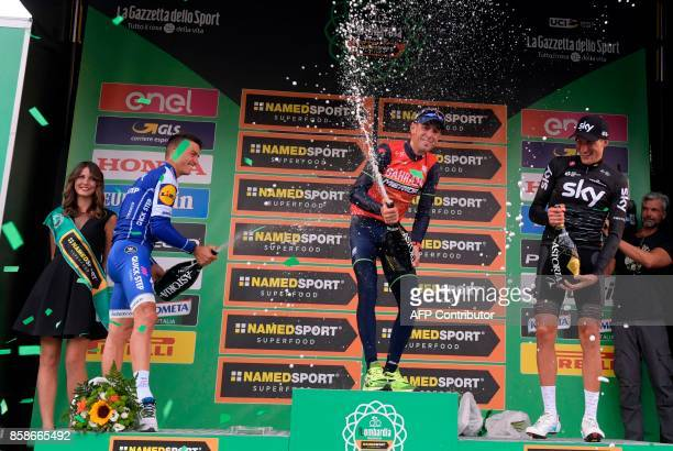 Secondplaced French Julien Alaphilippe from QuickStep floor team firstplaced Italian Vincenzo Nibali from BahreinMerida team and thridplaced Italian...