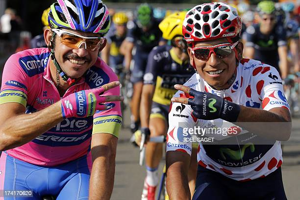 Secondplaced in the overall standings and best climber's polka dot jersey Colombia's Nairo Quintana and Colombia's Jose Serpa pose as they ride in...