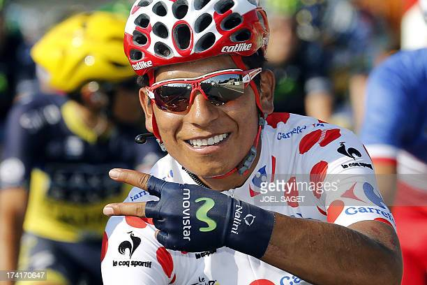 Secondplaced in the overall standings and best climber's polka dot jersey Colombia's Nairo Quintana makes the V sign for victory at the start of the...