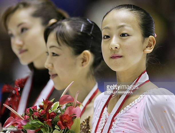 Secondplaced Japanese figure skater Mao Asada poses for photographers along with firstplaced Fumie Suguri and thirdplaced Shizuka Arakawa during an...