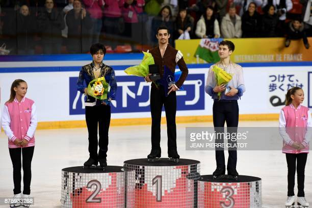 Secondplaced Japan's Shoma Uno firstplaced Spain's Javier Fernandez thirdplaced Uzbekistan's Misha Ge celebrate on the podium during the prize...