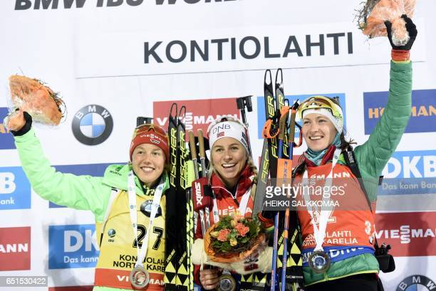 Secondplaced Laura Dahlmeier of Germany winner Tiril Eckhoff of Norway and thirdplaced Darya Domracheva of Belarus celebrate on the podium after the...