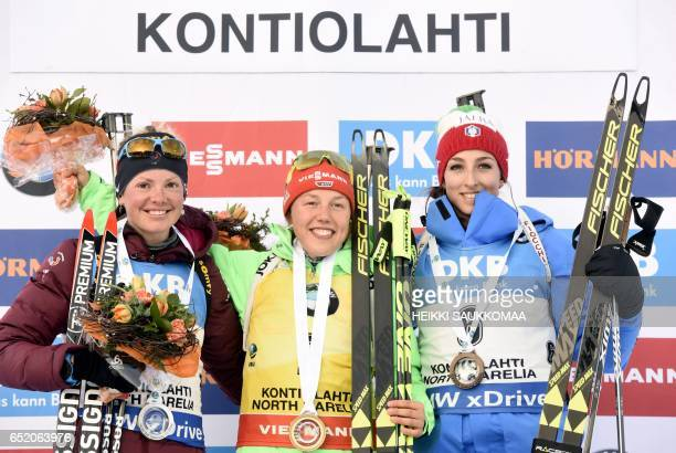 Secondplaced Marie Dorin Habert of France winner Laura Dahlmeier of Germany and thirdplaced Lisa Vittozzi of Italy celebrate on the podium after the...
