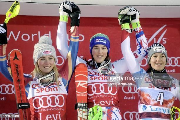 Secondplaced Mikaela Shiffrin of the United States winner Petra Vlhova of Slovakia and thirdplaced Wendy Holdener of Switzerland celebrate on the...