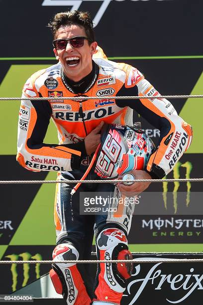 Secondplaced Repsol Honda Team's Spanish rider Marc Marquez celebrates on the podium after the Moto GP race of the Catalunya Grand Prix at the...